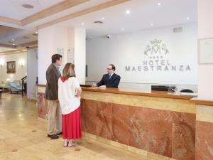 The lobby or reception area at Hotel Maestranza