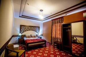 Cama o camas de una habitación en Arkanchi Hotel