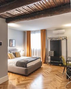 Ein Bett oder Betten in einem Zimmer der Unterkunft Relais Della Porta