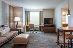 A seating area at Residence Inn by Marriott Orlando at Millenia
