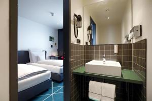 Een badkamer bij Sander Hotel