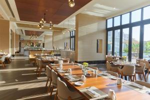 مطعم أو مكان آخر لتناول الطعام في Millennium Resort Salalah