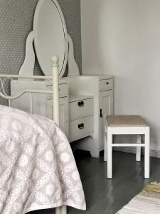 Łóżko lub łóżka piętrowe w pokoju w obiekcie Hotel Palo