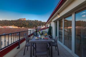 A balcony or terrace at Seven Wishes Boutique Residence