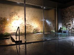 The swimming pool at or near Hotel Route-Inn Grand Muroran