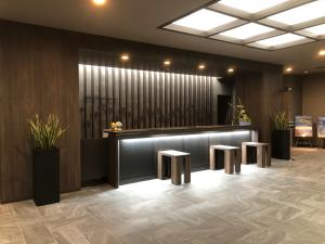 The lobby or reception area at Hotel Route-Inn Grand Muroran