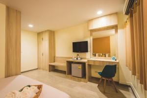 A television and/or entertainment center at New Suanmali hotel