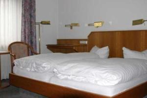 Ein Bett oder Betten in einem Zimmer der Unterkunft Hotel Ristorante Ätna
