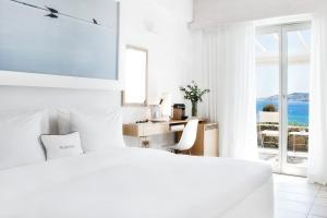 A bed or beds in a room at Grace Mykonos