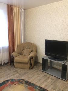 Телевизор и/или развлекательный центр в Хостел Матрёшка