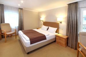 Ein Bett oder Betten in einem Zimmer der Unterkunft Hotel Löffler