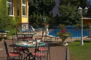 The swimming pool at or near Hotel Restaurant Du Parc