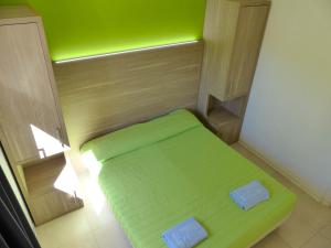 A bed or beds in a room at Belvedere Village