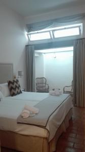 Un ou plusieurs lits dans un hébergement de l'établissement Casa Boutique La Pila del Pato