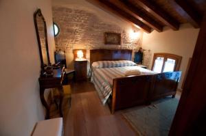 Letto o letti in una camera di Villa Fratta