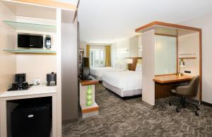 A bed or beds in a room at SpringHill Suites by Marriott Las Vegas Convention Center