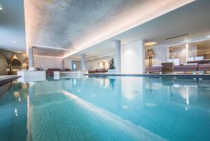 The swimming pool at or near Kronplatz-Resort Berghotel Zirm