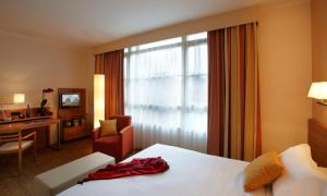 A bed or beds in a room at Citadines Saint-Germain-des-Prés Paris