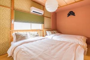 Tino Kawaraにあるベッド