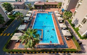Uma vista da piscina em Boudl Gardenia Resort ou nos arredores