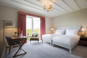A bed or beds in a room at Machrie Hotel & Golf Links