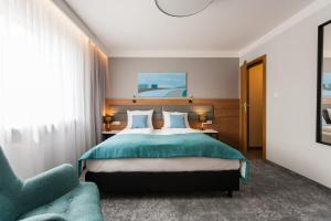 A bed or beds in a room at K4 APARTHOTEL KRAKÓW