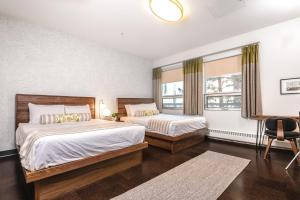 A bed or beds in a room at MacEwan University Residence