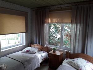A bed or beds in a room at Brīvdienu māja Melderi