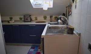 A kitchen or kitchenette at Le Petite Resort B&B