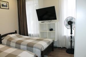 Телевизор и/или развлекательный центр в Квартиры в доме купчихи Морозовой