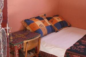 A bed or beds in a room at Hotel Aday