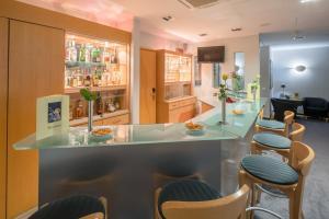 The lounge or bar area at Best Western Hotel im Forum Mülheim