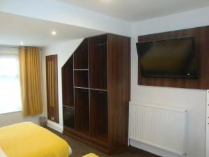 A television and/or entertainment centre at The Sandhurst Hotel