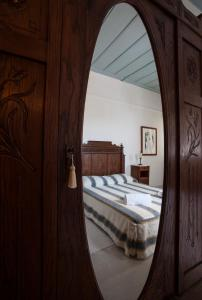 A bed or beds in a room at Nostos Guesthouse