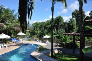 The swimming pool at or near Pousada Águas de Parati