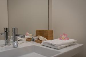 A bathroom at AC-Armazéns Cogumbreiro