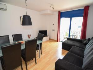 A seating area at LucasLand Apartments Sitges