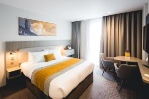 A bed or beds in a room at Maldron Hotel Newcastle
