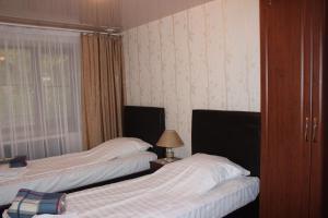 Кровать или кровати в номере Отель Каштан