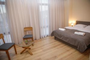 Кровать или кровати в номере Avlabari Terrace