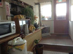 A kitchen or kitchenette at Minshuku Mutsukari