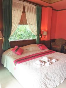 Ein Bett oder Betten in einem Zimmer der Unterkunft Cookies Hotel