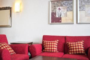 A seating area at Parkhotel Bochum by stays