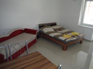 Posteľ alebo postele v izbe v ubytovaní Apartman Silver