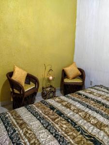 A bed or beds in a room at La Primavera Habitacion