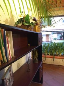 A television and/or entertainment center at La Primavera Habitacion