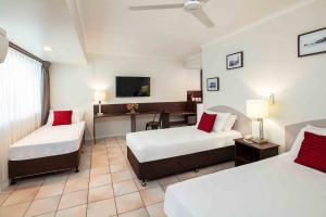 A bed or beds in a room at Hides Hotel