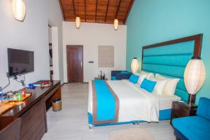 A bed or beds in a room at Amora Lagoon Hotel