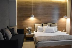 A bed or beds in a room at Maison Hotel