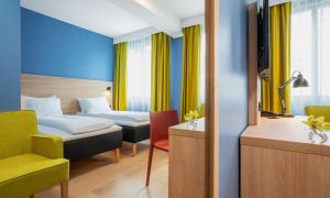 A bed or beds in a room at Thon Hotel Astoria